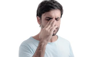 man with sinusitis headache